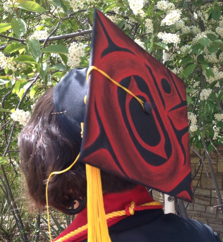 Northwest Coast Tlingit graduation cap designed by Clarissa Rizal painted and modeled by Ursala Hudson --  2014