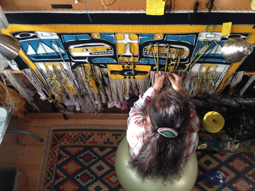 "Clarissa Rizal weaving the ""Resilience"" Chilkat robe she designed and wove, recently completed in June 2014"