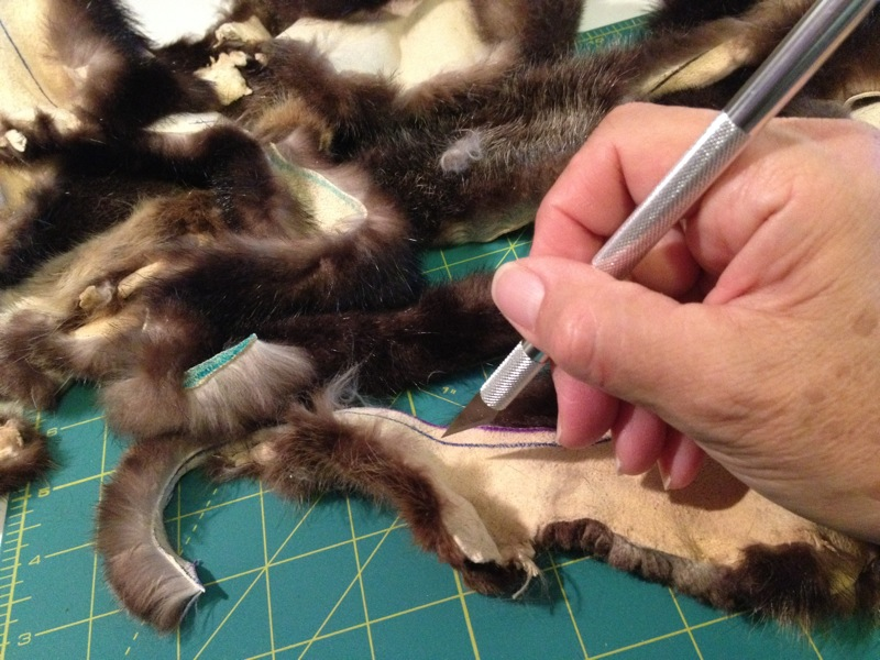 Like most furs, cut sea otter fur from the back side using a very sharp xacto blade or an old-fashioned shaving blade
