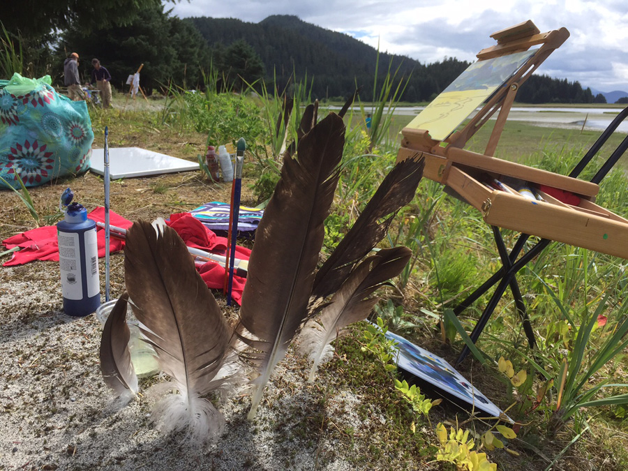 "Clarissa surrounds her ""work space"" with eagle feathers"