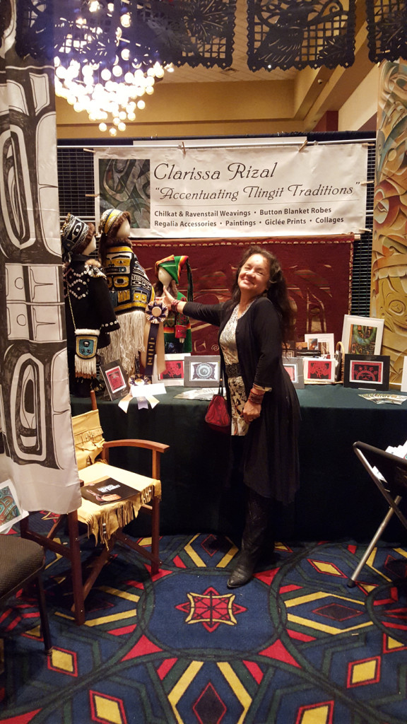 "Clarissa points to her Best of Class ribbon in Textiles of her ""Chilkat Child"", a 5-piece handwoven ensemble"